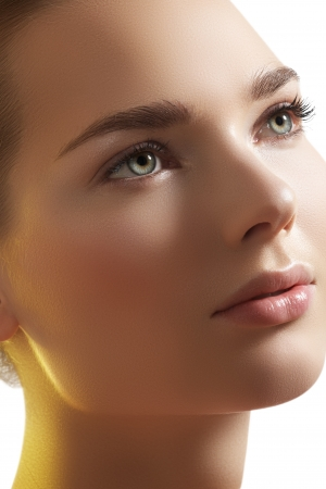 Natural beauty close-up portrait of beautiful young woman model face with clean skin photo