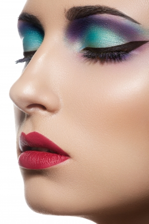 Closeup beauty portrait of attractive model face with bright visage  Multicolored eye makeup and vinous lips make-up  Stock Photo