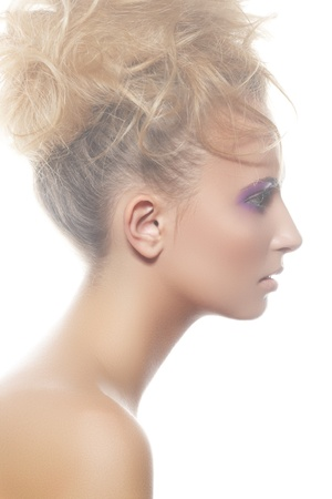 Wellness, spa portrait  Sensual profile of young woman model with big curly bun hairstyle, beautiful neck on white backgound  Natural white light mist  photo