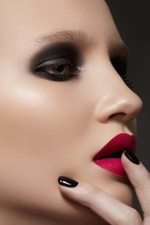 Beautiful close-up portrait of fashion woman model with glamour bright makeup, dark magenta lipstick, black nail polish  Evening catwalk style, trend visage and manicure  photo