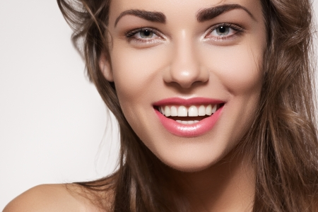 Happy beautiful young woman model with natural daily makeup  Lovely female smile with healthy white teeth  Stock Photo
