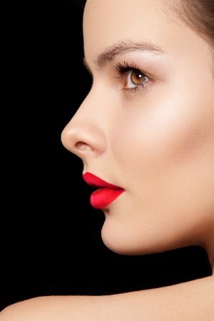 Close-up side view of beauty with clean skin   bright make-up  Chic fashion woman model