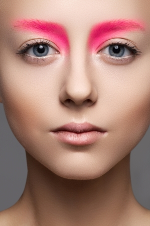 High fashion and beauty portrait photography  Beautiful girl model face with creative bright makeup like a doll, clean skin Stock Photo - 15892373