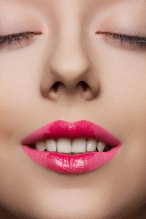 Model with fashion pink lips make-up, clean skin  Close-up beauty portrait of beautiful joyful woman s face with happy smile Stock Photo - 15892369
