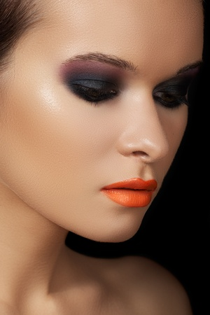 Close-up beauty portrait of attractive model face with bright make-up photo