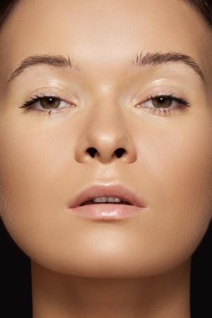 Spa, skincare, wellness, health   tan  Close-up portrait of beautiful female model face with purity health skin Foto de archivo