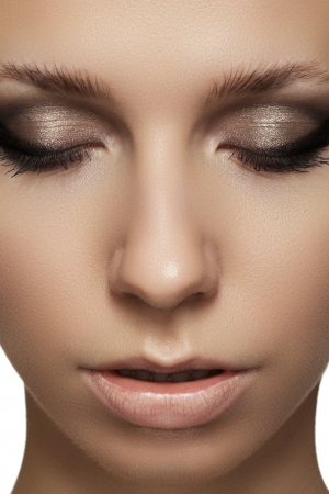 Closeup beauty portrait of attractive model face with fashion visage  Smoky eyes makeup and beige lips make-up
