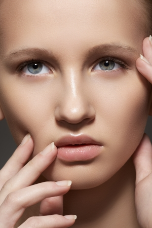 Make-up   cosmetics, manicure  Closeup portrait of beautiful woman model face with clean skin, full glossy lips  Natural skincare beauty, clean soft skin, french nails polish  photo