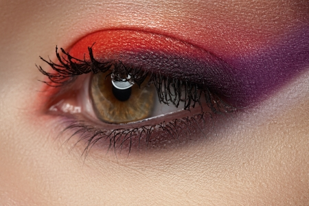 Macro of beautiful female eye with bright makeup  Cosmetics   visage