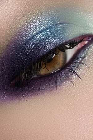 Elegance close-up of beautiful female eye with marine colors eyeshadow  Macro shot