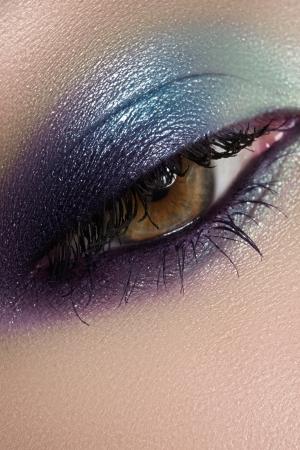 Elegance close-up of beautiful female eye with marine colors eyeshadow  Macro shot