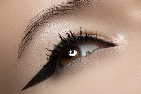 Cosmetics   make-up  Beautiful female eye with black liner make-up Stock Photo - 15892419