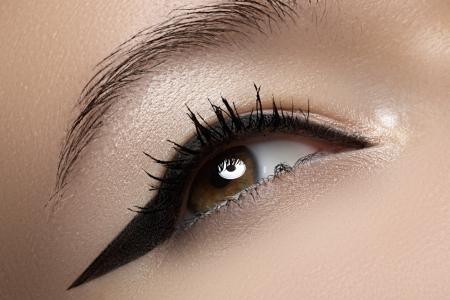 Cosmetics   make-up  Beautiful female eye with black liner make-up Stock Photo - 15892419