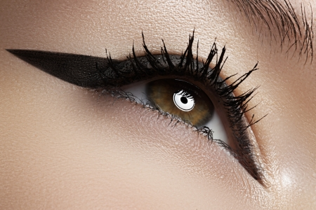 Cosmetics   make-up  Beautiful female eye with black liner make-up photo