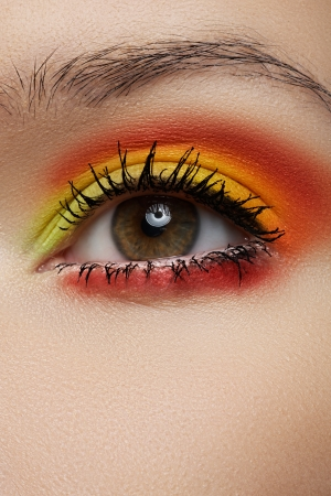 Cosmetics and beauty care  Macro close-up of beautiful green female eye with bright fashion runway make-up photo