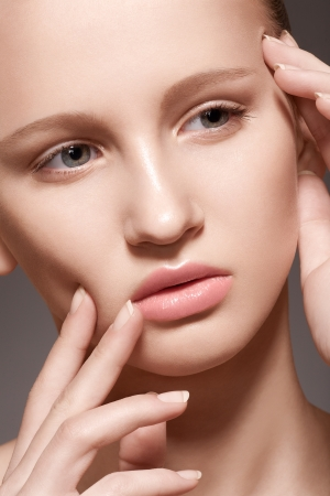 Make-up   cosmetics, manicure  Closeup portrait of beautiful woman model face with clean skin, full glossy lips photo