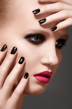 Beautiful close-up portrait of fashion woman model with glamour bright makeup, dark magenta lipstick, black nail polish photo