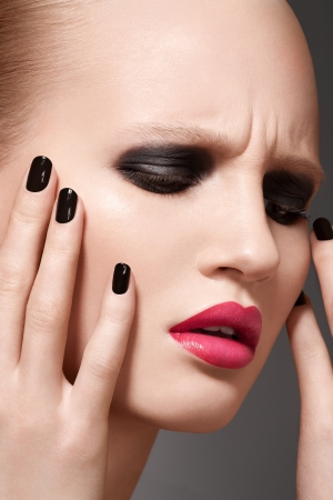 Beautiful close-up portrait of fashion woman model with glamour bright makeup, dark magenta lipstick, black nail polish Stock Photo - 15892372