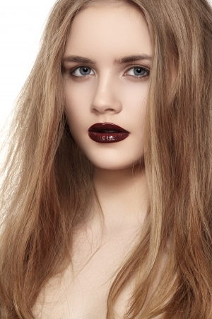 Portrait of young fashion woman with dark red lips makeup  photo