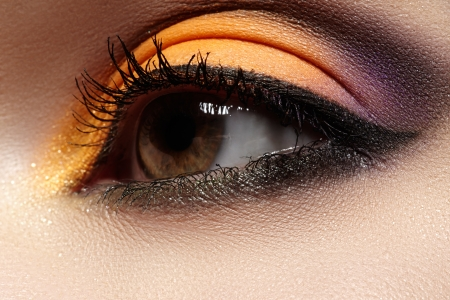 Elegance close-up of female eye with celebratory bright color eyeshadow  Macro shot of beautiful woman s face part  Wellness, cosmetics and make-up  Chic holiday visage  photo