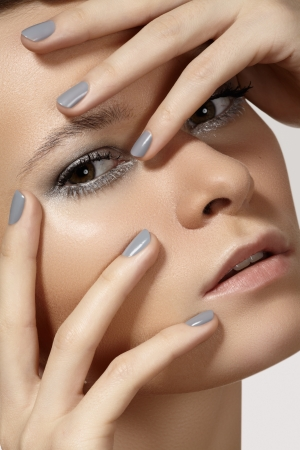Spa, beauty, skincare, wellness   health  Glamour close-up portrait of beautiful woman model face with purity healthy skin   silver make-up and grey manicure  Cold winter christmas makeup Stock Photo - 19509050