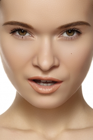Natural beauty close-up portrait of beautiful young woman model face with clean skin  Wellness, skincare and naturally make-up  photo