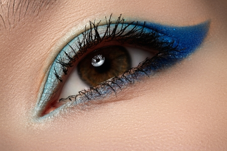 Elegance close-up of beautiful female eye with marine colors eyeshadow  Macro shot of beautiful woman s face part with makeup  Cosmetics, beauty and make-up  photo