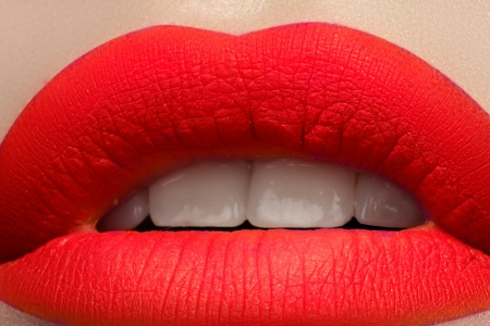 Close-up of beautiful full woman s lips with bright fashion mat pink makeup  Horizontal macro shot with magenta frosted lip make-up  photo