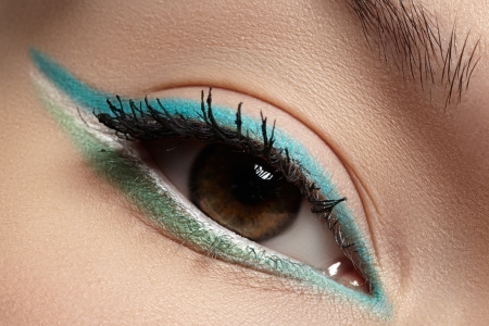 Elegance close-up of beautiful female eye with fashion trend mint colors eyeshadow and eyeliner  Macro shot of beautiful woman s face part with makeup  Cosmetics, beauty and make-up