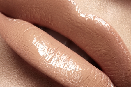Close-up of woman s lips with fashion natural beige lipstick makeup  Macro sexy pale lipgloss make-up Stock Photo - 19509015
