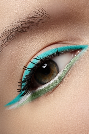 Elegance close-up of beautiful female eye with fashion trend mint colors eyeshadow and eyeliner  Macro shot of beautiful woman s face part with makeup  Cosmetics, beauty and make-up  photo