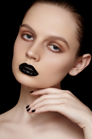 Portrait of young fashion woman with black lips makeup   nails polish  photo