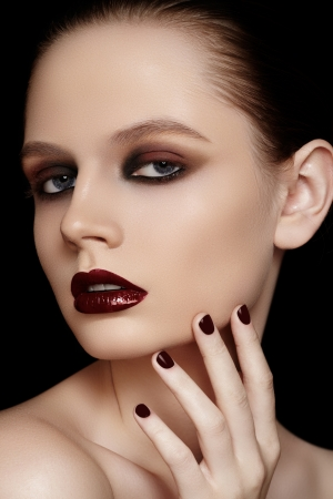slicked: Portrait of young fashion woman with dark red lips makeup   nails polish  Stock Photo