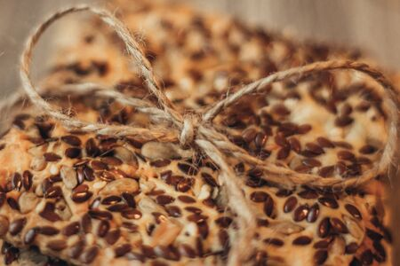 Whole-grain homemade cookies are tied with a linen twine. Bow closeup Stock Photo