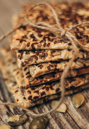 A stack of healthy and delicious cookies are tied with a linen twine. Close up Banco de Imagens