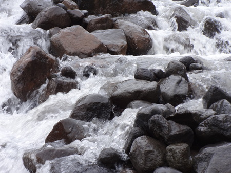 rushing water: A creek full of rushing water from melting snow Stock Photo