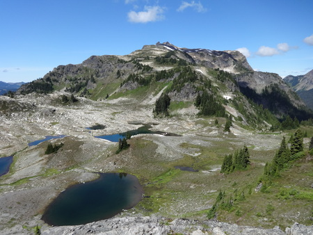 caved: Glacier carved tarns at a campsite of Yellow Aster Butte