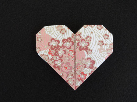 origami paper: Heart shaped origami paper Stock Photo