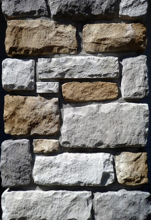 masonary: Tricolor stone wall washed by sunlight