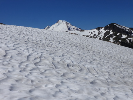 Ripple mark on a snow field and the summit view of Mount Baker in summer Stock Photo