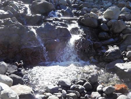 ripple: Sun hits a small waterfall on a mountain stream