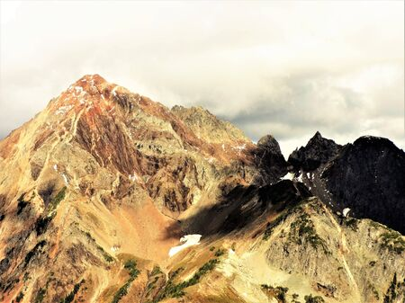 winchester: Sunlight hits the peak of Mt Larrabee in fall Stock Photo