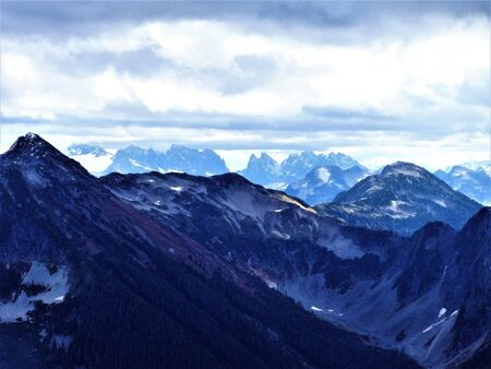 winchester: Storm clouds approaching a peak of the North Cascades Stock Photo