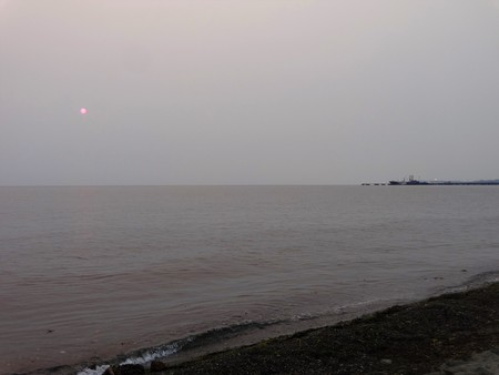 Smoke from Canadian wildfire hanging in the air at Neptune Beach in summer