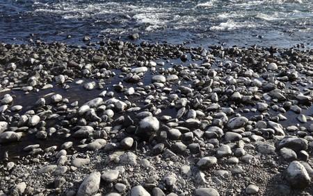 Rocks and pebbles in the Kuma River in Japan Archivio Fotografico