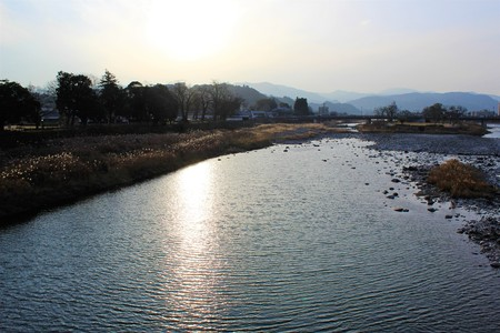 Winter afternoon sun reflecting on the surface of Kuma River in Japan Stock Photo