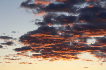 Sunlight reflected off of the lower parts of clouds before sunset