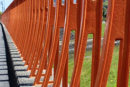 Orange painted a bridge guardrail Stock Photo