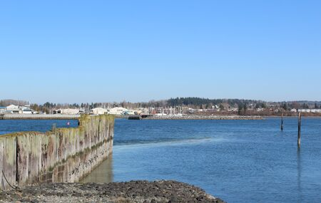 Calm water in Drayton Harbor with a view of a waterfront town