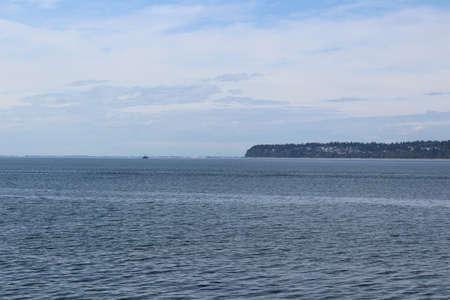 A distance view of White Rock peninsula and Boundary Bay in late summer